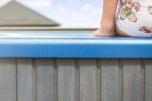 Woman sitting on hot tub