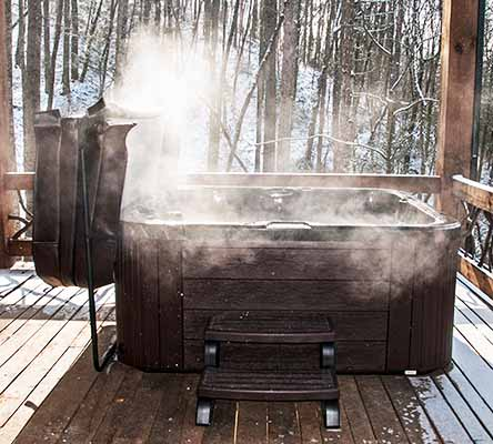 Steaming hot tub in winter