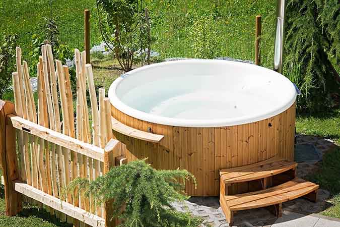 Outdoor hot tub in yard