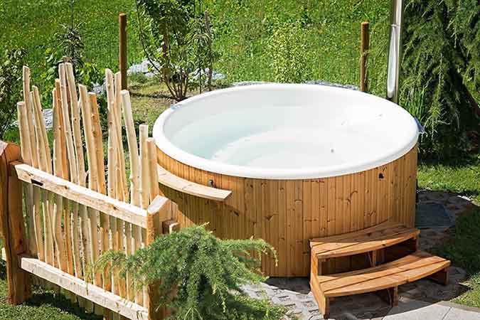 Outdoor hot tub in yard