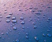Water droplets on reflective surface