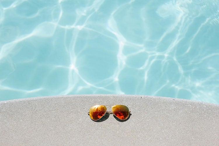Glasses near hot tub in summer heat
