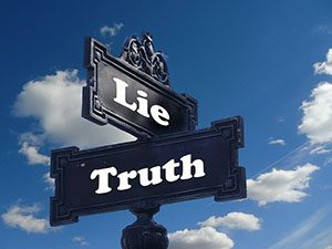 Sign posts with truth and lie on them