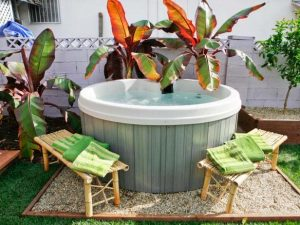 Hot tub surrounded by plants