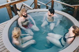 Friends sitting in hot tub