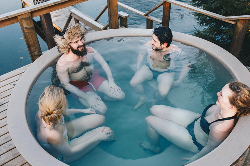 Friends sitting in hot tub
