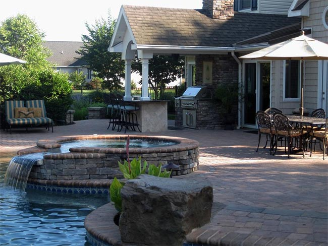 Hot tub with stone surfaces