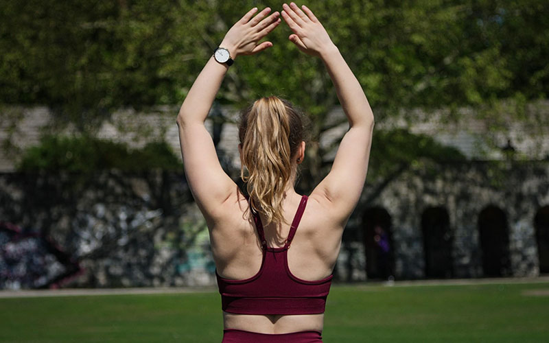 Young woman stretching before workout