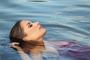 Swimmer floating in water