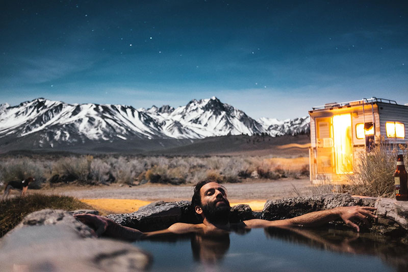 Man relaxing in hot tub as part of hot tub therapy