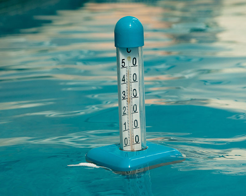 Thermometer floating in hot tub