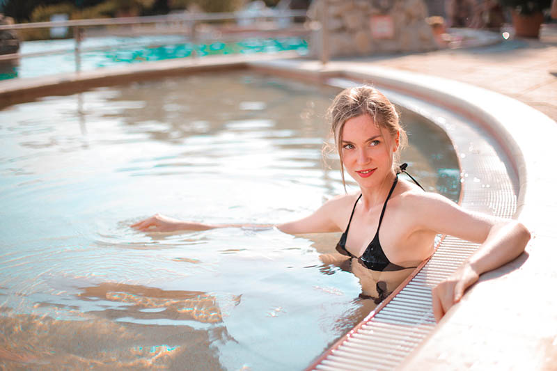 Woman in gigantic in-ground hot tub