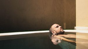 Man floating in luxury hot tub